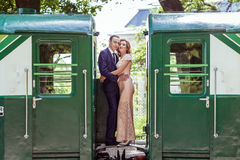 A couple between by wagons Royalty Free Stock Images