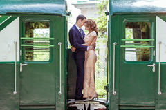 A couple between by wagons Stock Image