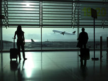Couple waiting at  the airport Royalty Free Stock Photos