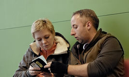 Couple waiting at airport terminal with tickets Stock Photography