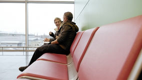 Couple waiting at airport terminal with tickets Royalty Free Stock Photos