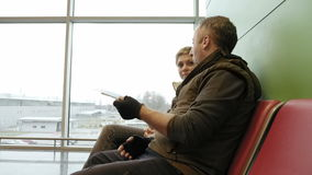 Couple waiting at airport terminal with tickets stock video footage