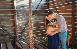 Couple waiting for baby photo shoot in a wooden house Royalty Free Stock Photography