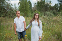 Couple waiting for baby on a walk Stock Photos