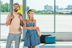 Couple waiting for boarding in airport Royalty Free Stock Photos