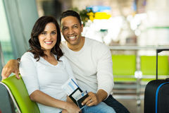 Couple waiting flight airport Stock Photo