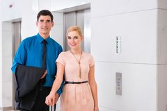 Couple waiting for hotel elevator or lift Stock Image
