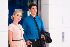 Couple waiting for hotel elevator Royalty Free Stock Photo