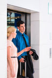 Couple waiting for hotel elevator Royalty Free Stock Photography