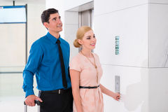 Couple waiting for hotel elevator. Or lift Royalty Free Stock Images