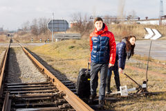 Couple waiting for the train near a level crossing Stock Image