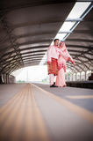 Couple waiting for train at station Royalty Free Stock Photos