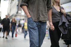 Couple waking and holding hands Stock Photo