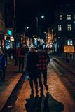 Couple waking on the streets at night royalty free stock photos