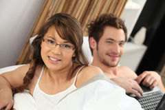 Couple waking up. At then weekend Royalty Free Stock Image