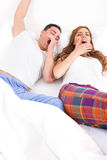 Couple waking up in the bedroom and stretches Stock Image