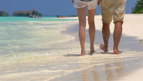 Couple Walk Along Beach. Close Up Of Feet and Waves. stock footage