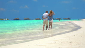 Couple Walk Along Beach. stock video