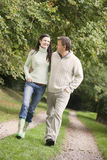 Couple on walk along woodland path Royalty Free Stock Photography