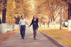 Couple walk in autumn park Royalty Free Stock Image