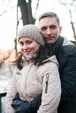 Couple on walk in autumn park. Portrait of women and men on walk in autumn forest royalty free stock photos