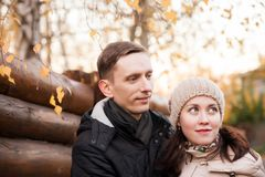 Couple on walk in autumn park. Young girl with guy in autumn park royalty free stock images