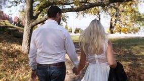 Couple on walk backside stock footage