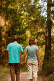 Couple walk in forest Stock Images