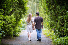 Couple walk hand park Stock Photo
