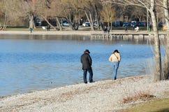 Couple walk at the lake 2 stock photography