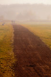 Couple walk in the mist Royalty Free Stock Photo
