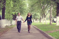 Couple walk in park Stock Image