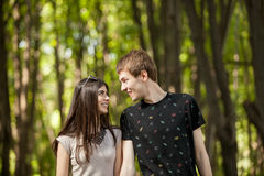 Couple in a walk in the park. Outdoor photo. Happy relationship Royalty Free Stock Photography