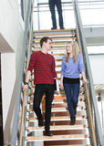 Couple walk the stairs Royalty Free Stock Photos
