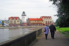 A couple walk towards the Fish village in Kaliningrad Stock Photos