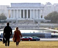 A couple walk towards to the Lincoln memorial. National mall area alway great for photos stock image
