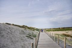 Couple on the walkway over the dunes stock photo