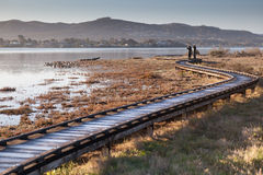 A couple walked on a boardwalk Stock Photos