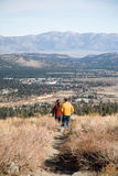 Couple walking. Couple hiking above Mammoth Lakes in California Stock Images