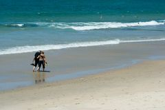 Couple walking. Along the beach royalty free stock photo