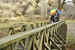 Couple Walking Across A Bridge Royalty Free Stock Images