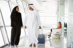 Couple walking through airport departure lounge Royalty Free Stock Photography
