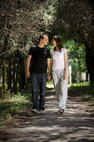 Couple walking in an alley. Young men and women walking in the middle of an alley Royalty Free Stock Photography