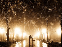 Couple walking at alley in night. Lights. Photo in vintage multicolor style Royalty Free Stock Photo