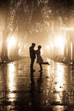 Couple walking at alley in night lights. Photo in vintage yellow style #17 Stock Photography