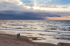 Couple walking along the beach at the polish seaside.  royalty free stock image