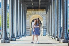 Couple walking along Bir-Hakeim bridge in Paris, France Royalty Free Stock Photos