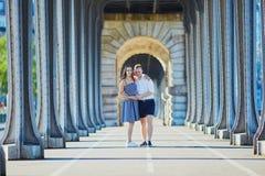 Couple walking along Bir-Hakeim bridge in Paris, France Stock Photo