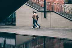 Couple walking along canal