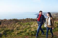 Couple Walking Along Coastal Path Royalty Free Stock Photos